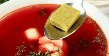 Bowl of soup with bouillon cube, close up